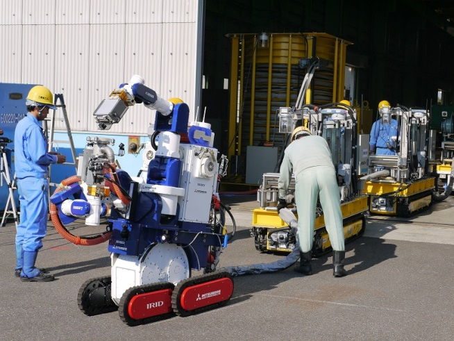 Text Box: Figure 4: Decontamination robots developed by the International Research Institute for Nuclear Decommissioning for the upper floors of reactor building of the Fukushima Daiichi nuclear power plant